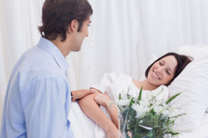 Man visiting his girlfriend in the hospital