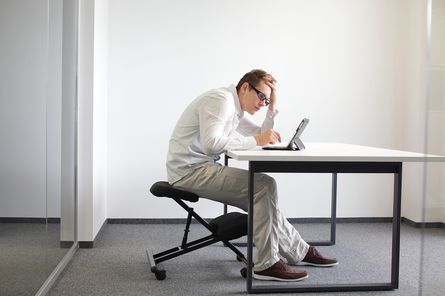 Man with poor posture at desk